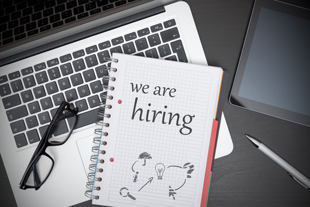 We are hiring text in notepad. Human resources, recruitment concept on desk Zdjęcie Seryjne
