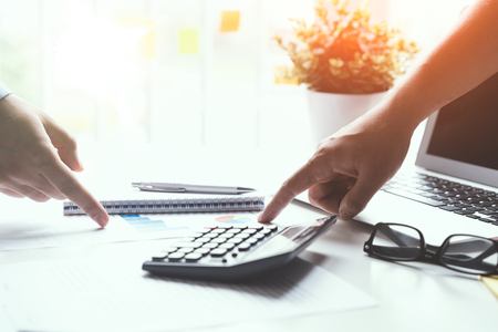 Group of employees co-operate on a budget. Finance concept in office. Zdjęcie Seryjne - 125165180