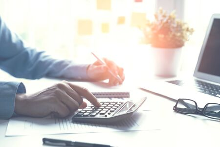Accountant counts tax, works in the office. Business and finance concept Zdjęcie Seryjne - 125165259
