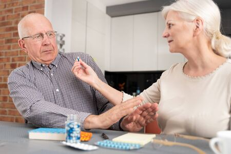 Senior man does not want to take medicine. Elderly people health care concept