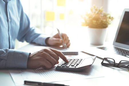 Accountant counts tax, works in the office. Business and finance concept Zdjęcie Seryjne - 125165359