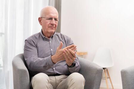 Elderly male is expressing pain. Arthritis, rheumatoid, pain concept Фото со стока