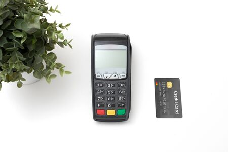 Payment terminal, credit card machine with credit card top view Фото со стока