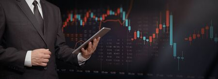 Stock market trading graph, investment candlestick chart. Investor with digital tablet, copy space web banner background Фото со стока