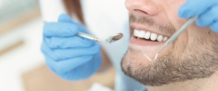Young man at the dentist. Dental care, treatment of teeth, taking care of teeth