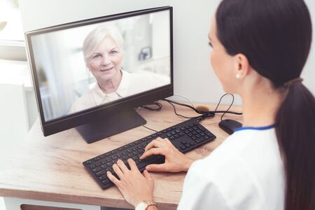 Doctor and senior woman patient medical consultation, telehealth, telemedicine, remote health care concept.