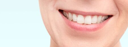 Smiling woman mouth with white teeth. Copy space web banner background.