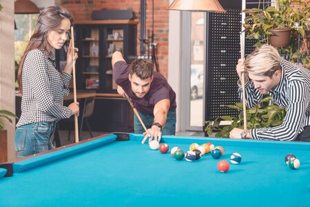 Group of employees playing in billiards at office. Break from work in the relaxation room Reklamní fotografie