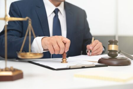 Lawyer or attorney working with papers in office. Law and justice concept.