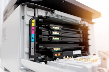 Toners in the laser printer. Multifunction printer, scanner, copier device. Stock Photo