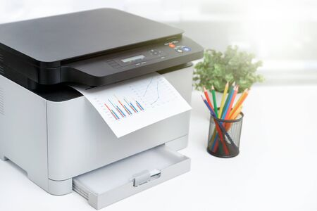 Multifunction device, copier, scanner, printer in office. Professional laser printer. Stock Photo