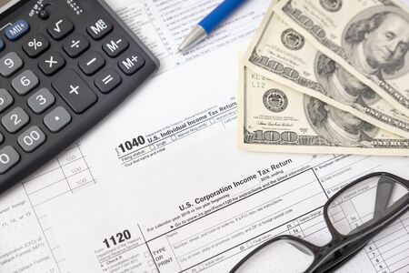 US tax form on desk composition. Tax income concept
