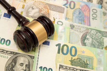 Gavel on banknotes. Law, money, corruption concept