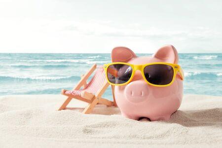 Piggy bank resting on vacation. Saving money, travel concept