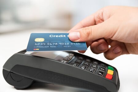 Man using credit card in shop. Cashless payment with pos terminal Reklamní fotografie