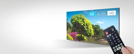 4K resolution display concept. TV screen panel with remote control in hand. Web banner background