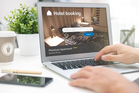 Man makes hotel reservations via the internet. Tourism, vacation concept