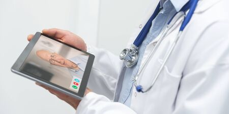 Doctor and senior man patient medical consultation. Telemedicine, remote health care concept.