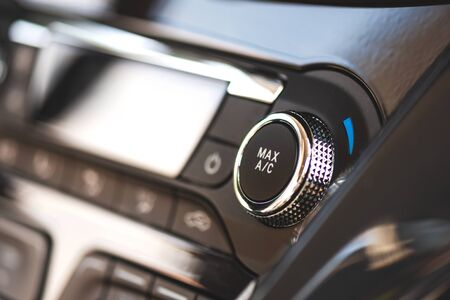 Air conditioner control panel, car cooling system. Close up photo of front panel with AC knob