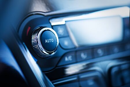 Air conditioner control panel, car cooling system. Close up photo of front panel with AC knob 版權商用圖片