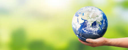 Hand holding Earth globe. World environment day concept.