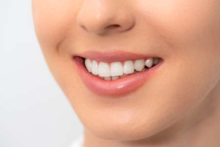 Woman with perfect smile. Teeth whitening, dental care concept