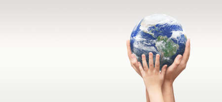 Earth globe in family hands. World environment day concept.