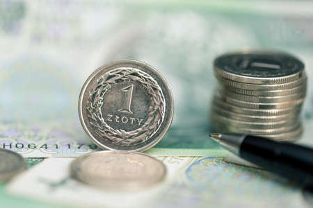 Polish money, coin stack on polish banknotes. Business, finance concept