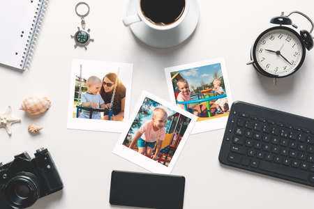 Stack of photo frames on desk. Printed photographs, photo lab concept, top view