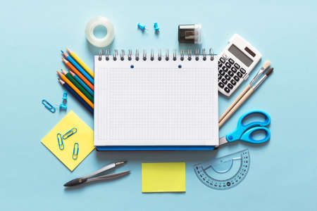 Back to school, stationery on blue background. Image with copy space. Imagens