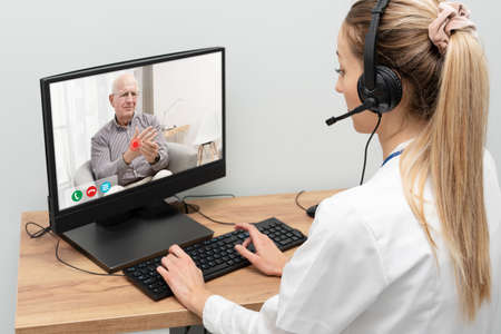 Doctor and senior man patient medical consultation, telehealth, telemedicine, remote health care concept.