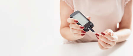 Woman checking blood sugar level. Diabetes health care concept