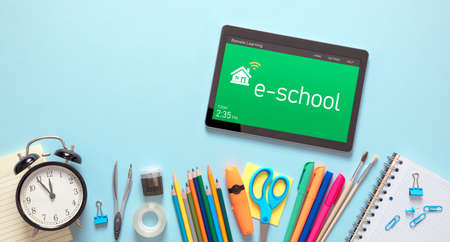 Remote learning, e-learning concept. Tablet with remote learning system, school supplies