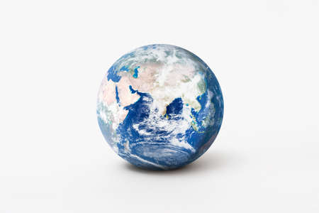 World environment day concept. Earth globe model with shadow on white background. Imagens