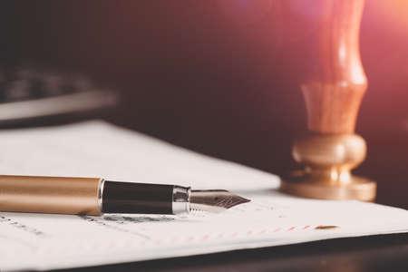 Law, notary background theme. Fountain pen and handmade paper on desk Zdjęcie Seryjne