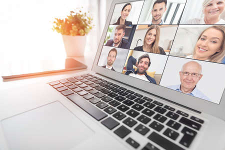 Video conference with multiple employees. Laptop application for remote work and study from home. Stock Photo
