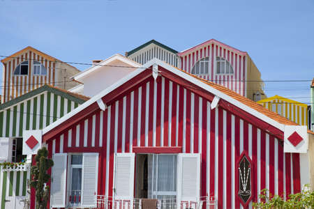 Stock Photo - Candy Striped Fishermans Shacks photo