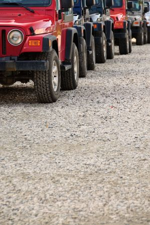 backroad: Many equal cross-country vehicals in a close convoy Stock Photo