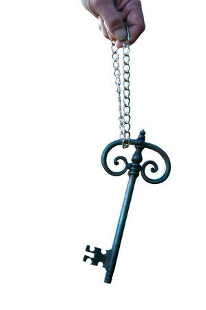 slot met sleuteltje: En oude big sunlit sleutel met een keten Stockfoto