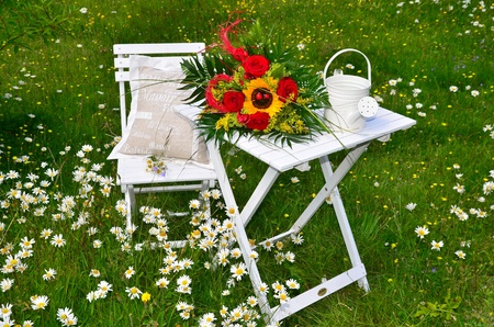romantic garden flowers summer garden chair photo
