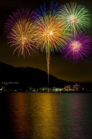 Many fireworks on lake Stock Photo
