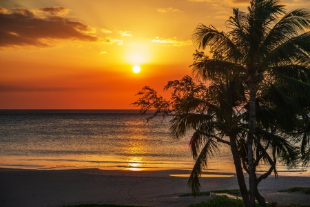 sunset beach at kona Stock Photo