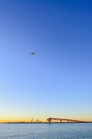 sunrise with airplane photo