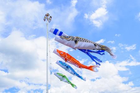 Colourful carp streamers or Koinobori flutter in the wind. Standard-Bild