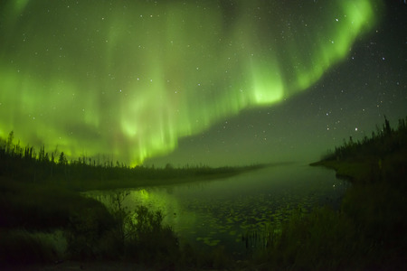 Northern lights aurora borealis in the night sky Stock Photo
