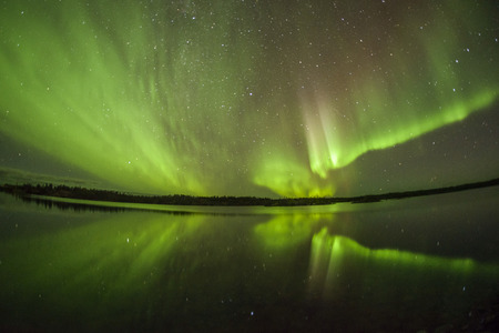 Northern lights aurora borealis in the night sky Stok Fotoğraf