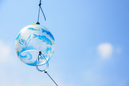 Japanese wind chime against blue sky