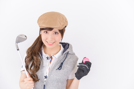 Young woman golf player smiling isolated on white background.