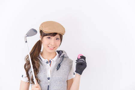 woman golf: Young woman golf player smiling isolated on white background.