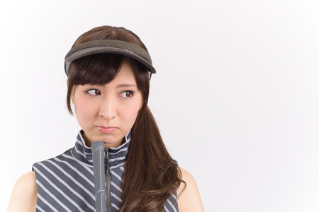grouchy: Young woman golf player disappointed lookking isolated on white background.